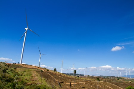 windy energy: Power of wind turbine generating electricity clean energy with cloud background on the blue sky.Global ecology.Clean energy concept save the world Stock Photo