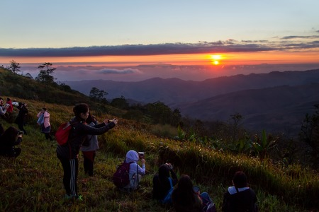 come in: Phetchabun, Thailand - January, 21, 2017 : Tourists come to see and photograph the sunrise in the morning at Phu Lom Lo, Phu Hin Rong Kla National Park, Phetchabun, Thailand. Editorial