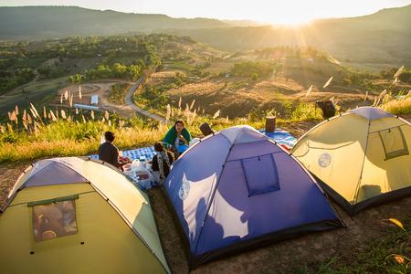 Phetchabun, Thailand - January, 22, 2017 : Tourist Camping on the hill with sunshine in the sunrise at Takhian Ngoa Mountain Phetchabun, Thailand.Natural summer landscape.