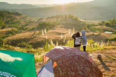 campsite: Phetchabun, Thailand - January, 22, 2017 : Tourist Camping on the hill with sunshine in the sunrise at Takhian Ngoa Mountain Phetchabun, Thailand.Natural summer landscape.