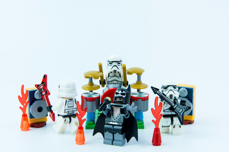 stormtrooper: Nonthaburi, Thailand - February, 16, 2017 : Lego star wars stormtrooper and Lego Batman playing music rock band on white background copy space.Band of musicians.Nonthaburi, Thailand