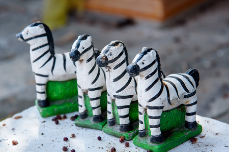Small zebra statues for pray the god Stock Photo