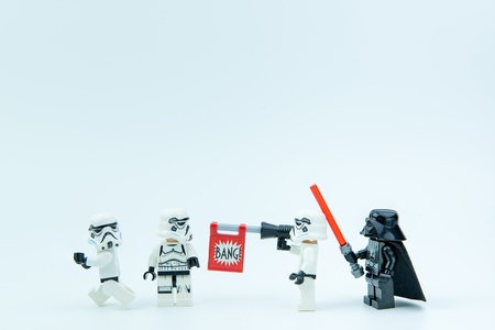 Nonthaburi, Thailand - March, 07, 2017 : Lego star wars stormtrooper fake shooting guns on friends isolated on white background. Editorial
