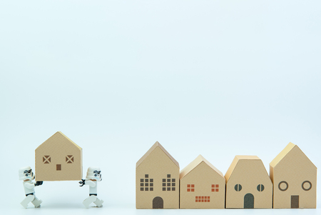 Nonthaburi, Thailand - March, 07, 2017 : Lego star wars stormtrooper help together carry the paper house.Real estate concept, New house concept.