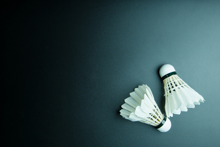 Shuttlecock isolated on black background with copy space
