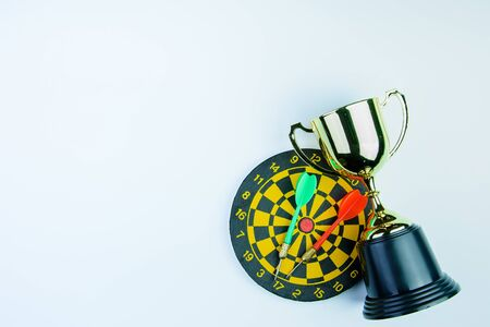 Golden trophy, Darts with crotch isolated on white background with copy space.Concept winner