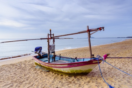 Fishing boats on the beach over cloudy sky at Prachuap Khiri Khan, Thailand Stock Photo