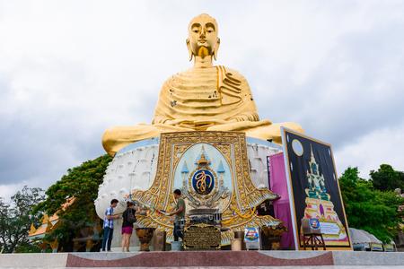 Prachuap Khiri Khan, Thailand - April, 18, 2017 : A golden Buddha statue named as Pra Buddha Kitisirichai is located at temple Wat Thang Sai on mountain Thongchai at Prachuap Khiri Khan, Thailand