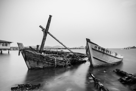 abandon: Chon Buri, Thailand - April, 27, 2017 : Long exposure technique of shipwreck or abandoned shipwreck in the sea at Sattahip, Chon Buri, Thailand.Black and white picture