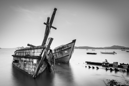ship wreck: Chon Buri, Thailand - April, 27, 2017 : Long exposure technique of shipwreck or abandoned shipwreck in the sea at Sattahip, Chon Buri, Thailand.Black and white picture
