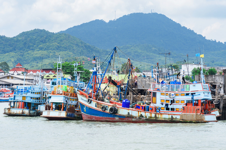 Rayong, Thailand - April, 28, 2017 : Thailand fishing boat at dock on the sea at Rayong, Thailand Editorial