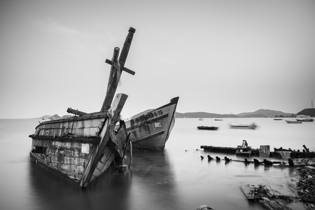 Chon Buri, Thailand - April, 27, 2017 : Long exposure technique of shipwreck or abandoned shipwreck in the sea at Sattahip, Chon Buri, Thailand.Black and white picture