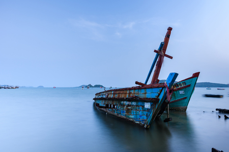 abandon: Chon Buri, Thailand - April, 27, 2017 : Long exposure technique of shipwreck or abandoned shipwreck in the sea at Sattahip, Chon Buri, Thailand.