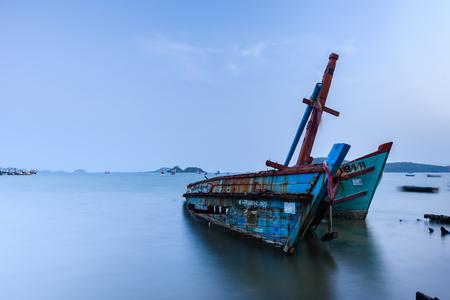 Chon Buri, Thailand - April, 27, 2017 : Long exposure technique of shipwreck or abandoned shipwreck in the sea at Sattahip, Chon Buri, Thailand.