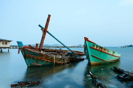 the sunken: Chon Buri, Thailand - April, 27, 2017 : Long exposure technique of shipwreck or abandoned shipwreck in the sea at Sattahip, Chon Buri, Thailand.