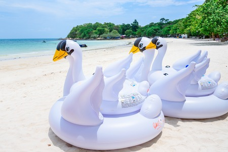 Rayong, Thailand - April, 28, 2017 : Swan swim tube on the beach Inflatable swan.Fantasy Swim Ring for Summer sea Trip on the beach at the Koh Samet island, Rayong, Thailand Editorial