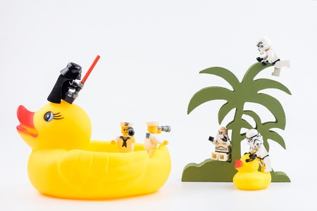 Nonthabure, Thailand - May, 17, 2017 : Lego sailor passenger yellow rubber duck using binoculars looking Lego stormtrooper on the island for to help. Editorial