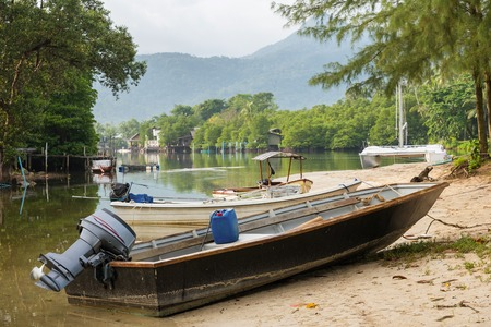 The small boat parked in a small canal at the mangrove forest.Thailand.