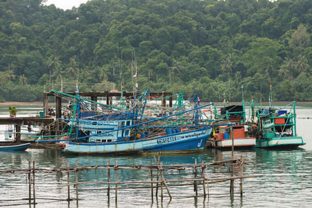 trat: Trat, Thailand - May, 21, 2017 : Thailand fishing boat at dock on the sea in Koh Chang island Trat, Thailand.