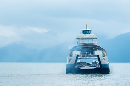 Trat, Thailand - May, 20, 2017 : Unidentified name Tourists passenger ferry boat going to Koh Chang island from Ao Thammachart Pier quay  on Trat Thailand. Editorial