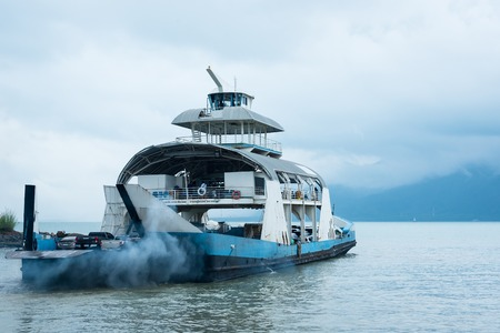 trat: Trat, Thailand - May, 20, 2017 : Unidentified name Tourists passenger ferry boat going to Koh Chang island from Ao Thammachart Pier quay  on Trat Thailand. Editorial