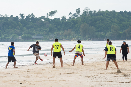 trat: Trat, Thailand - May, 20, 2017 : Unidentified name group of friends playing football on the Prao Beach in Koh Chang island Trat, Thailand.