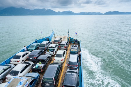 trat: Trat, Thailand - May, 20, 2017 : Cars parked on a ferry.Tourists passenger ferry boat going to Koh Chang island from Ao Thammachart Pier quay on Trat Thailand.