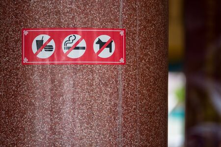 banned: No smoking, No Dog, No food sign in public place