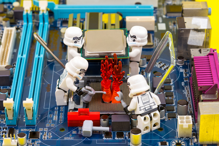 menace: Nonthaburi, Thailand - June, 03, 2017 : Lego star wars stormtrooper help to extinguish the burning fire in socket cpu on a computer motherboard.