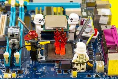 Nonthaburi, Thailand - June, 03, 2017 : Lego star wars stormtrooper help to extinguish the burning fire in socket cpu on a computer motherboard.