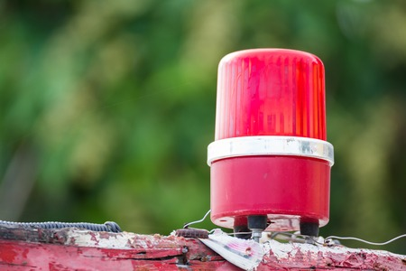 critical care: Red siren lamp on the roof of the boat