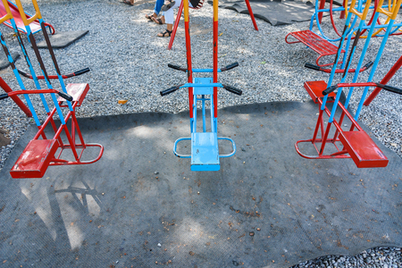 Closeup of colorful swings in playground area at park