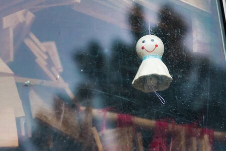 lucky charm: Chasing rain Japanese doll hanging in the window
