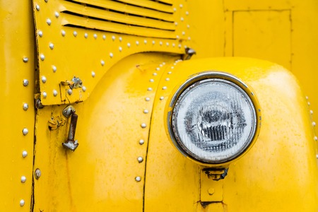 lamp light: Front lights of yellow school bus in vintage style