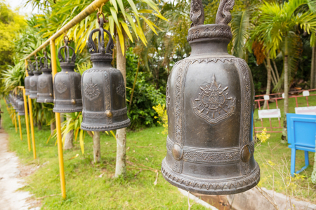 Phetchabun, Thailand - July, 15, 2017 : A line of Temple bell for buddhist to worship at kanchana pisek grand pagoda in Khao Kho Phetchabun Thailand.