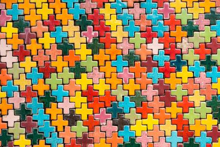 Walls covered with colorful ceramic tiles in Tao Hong Tai Ceramics Factory at Ratchaburi, Thailand Stock Photo