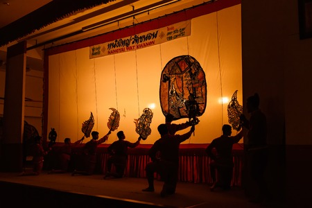 Ratchaburi, Thailand - July, 23, 2017 : Unidentified name Man showt large shadow play is performed in Wat Khanon temple at Ratchaburi, Thailand Editorial