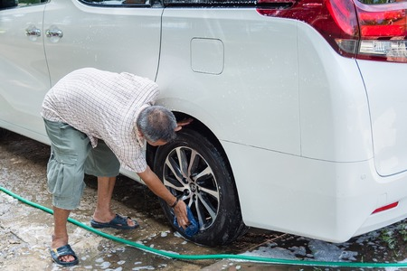 shiny car: Ratchaburi, Thailand - July, 23, 2017 : Unidentified name Man cleaning his car in Wat Khanon at Ratchaburi, Thailand