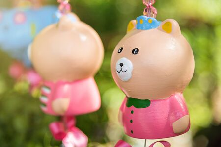 Colorful animal ceramic doll hanging in the garden