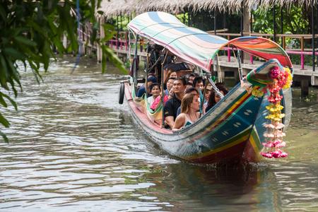 Bangkok, Thailand - July, 30, 2017 : Unidentified name foreign tourists visiting by boat in Khlong Lat Mayom Floating Market Bangkok, Thailand.