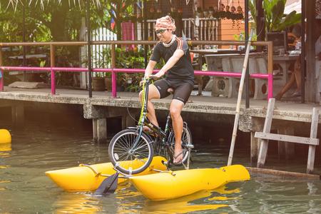 Bangkok, Thailand - July, 30, 2017 : Unidentified name Tourist enjoy with pedal bicycle boat on the canal at Khlong Lat Mayom Floating Market Bangkok, Thailand.