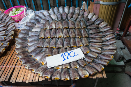 Stack of salted dried small fish that have dried Skin Gourami Fish (Pla salid fish or Sepat siam) that can be found in many local fish markets in Thailand.
