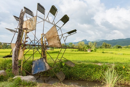 Turbine baler in paddy rice field.Thailand
