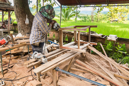 Nan, Thailand - September, 24, 2017 : Unidentified name Carpenter is working in Rongngæ temple at Nan Province, Thailand Editorial