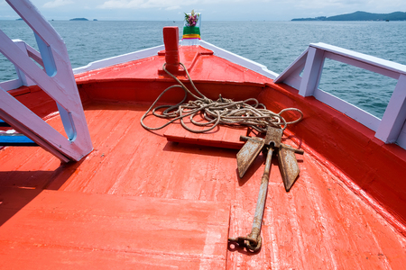 Rope and Small anchor on board ship deck