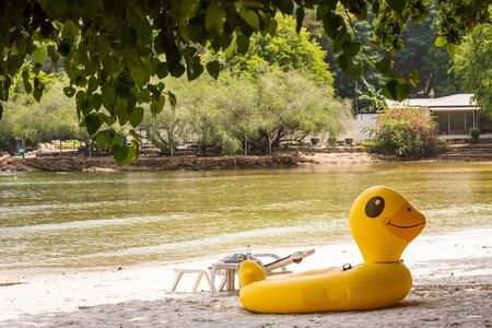 Yellow Duck swim tube on the beach Inflatable duck.Fantasy Swim Ring for Summer sea Trip on the beach at the Koh Samet island, Rayong, Thailand