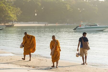 Rayong, Thailand - October, 08, 2017 : Unidentified name buddhist monk was walking alms offering food in the morning on the beach at the Koh Samet island, Rayong, Thailand