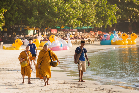 limosna: Rayong, Thailand - October, 08, 2017 : Unidentified name buddhist monk was walking alms offering food in the morning on the beach at the Koh Samet island, Rayong, Thailand