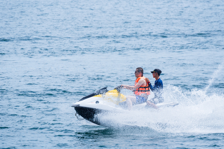 Rayong, Thailand - October, 08, 2017 : Unidentified name tourist on Jet Ski, summer holiday by the sea at the Koh Samet island, Rayong, Thailand
