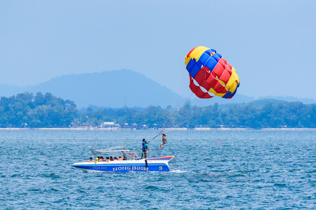 Rayong, Thailand - October, 07, 2017 : Unidentified name tourist sea parasailing water.Flying on a parachute behind a boat on a summer holiday by the sea in Rayong, Thailand